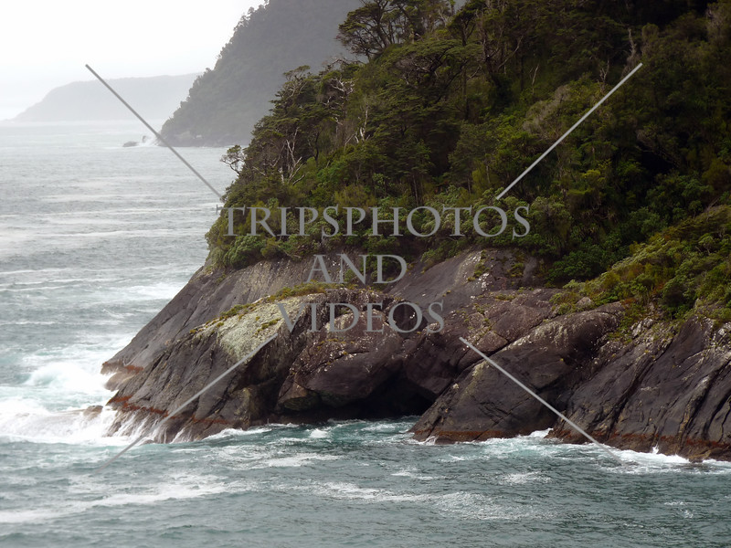 Scenic view along Milford Sound in Fiordland National Park, New Zealand.
