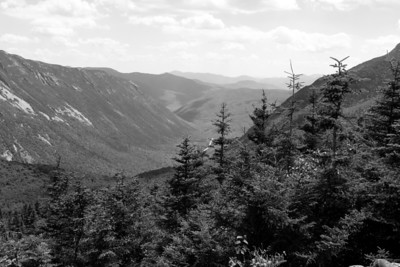 Crawford Notch from Mt. Avalon.  Webster cliffs to the left.  US 302 running up the center of the notch.  If you look closely you can see the rail cut to the right.