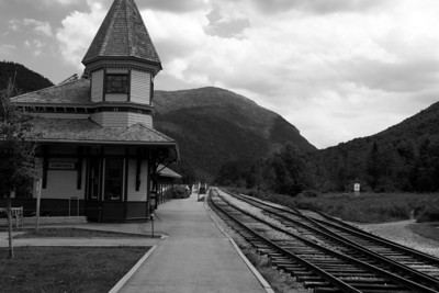 """Crawford Depot looking south to to the Gateway of the Notch.  The milepost says """"P-56"""": 56 miles to Portland, ME."""