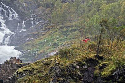 Kjosfossen Waterfall and a Huldra, a seductive forest creature.