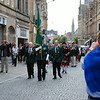 The standard bearer followed by the pipers