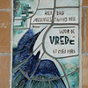 A tile plaque commemorating the visit to Ypres of Pope John Paul II in May1985