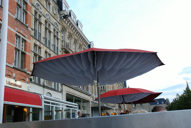 The mushroom-like umbrellas in an outdoor restaurant in the square