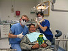 Flat Stanley with Dr. Bickel, Ms. Marshall, and a Soldier who was having his teeth worked on.  Flat Stanley had a checkup also.  His teeth were in perfect condition.  He wanted to tell CJ to brush his teeth really good two times a day.