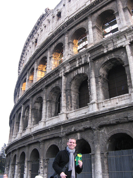 Flat Stanley and Brian in Rome, Italy at the Colosseum.  The Colosseum was completed in 80 A.D.  It is like a big sports stadium.  Gladiators used to fight here.  They would also fill the bottom with water and stage naval battles with big boats.