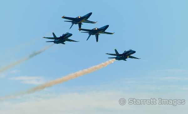 Blue Angels, two flying inverted.