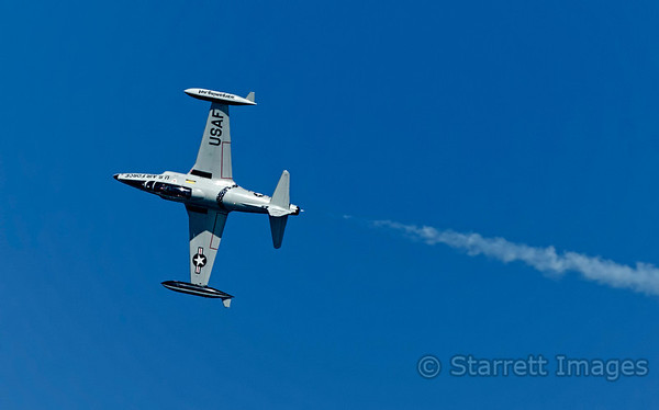 USAF T-33 starting a roll.