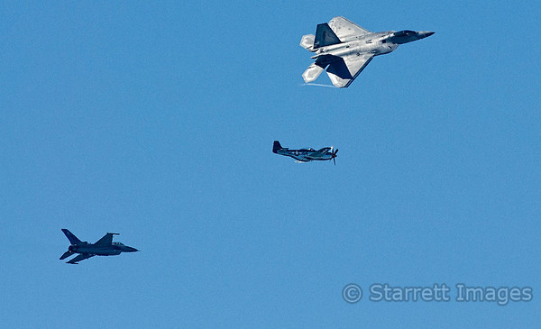 Lockheed Martin F-22 Raptor with a vintage P-51 Mustang