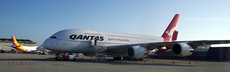 The Qantas A380 with a couple 747-400s behind.