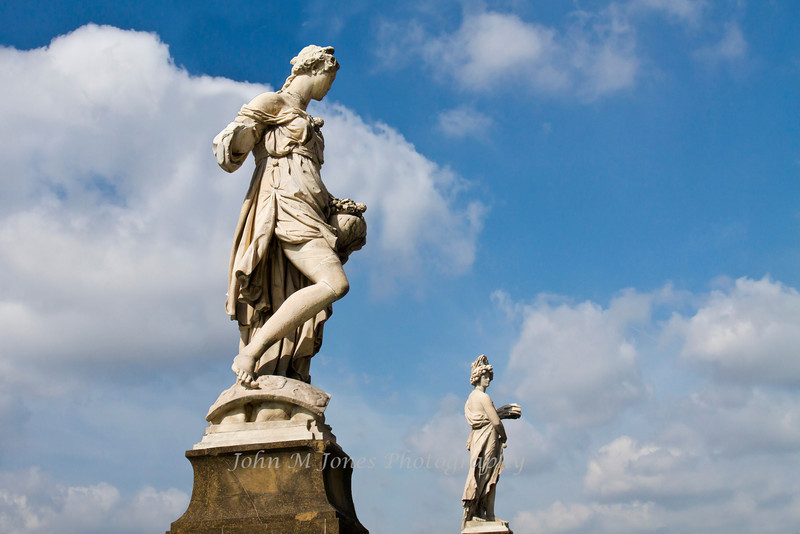 Two of the Four Seasons statues on Ponte Santa Trinita added in 1608 for Cosimo II's marriage to Maria of Austria, Florence, Firenze, Italy