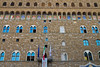 Under the arches of Palazzo Vecchio, nine Coats of Arms of the Florentine Republic are repeated, Florence, Firenze, Italy