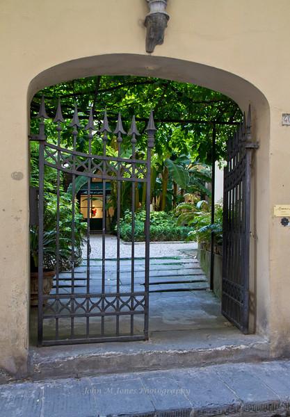 Courtyard gate on Borgo Santi Apostoli Street, Florence, Firenze, Italy