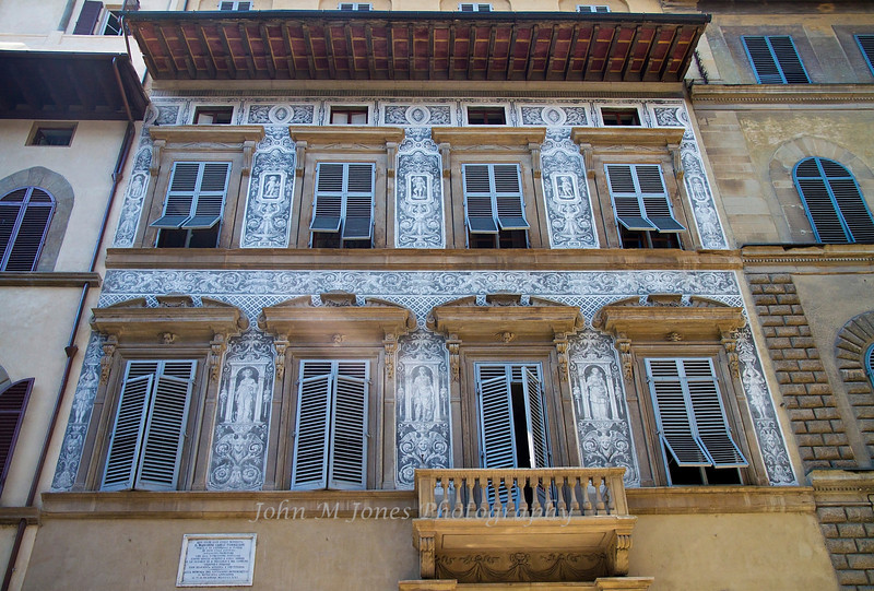 Building decorated with Graffiti, or etching through a white layer of plaster to reveal a dark layer of plaster, Florence, Firenze, Italy