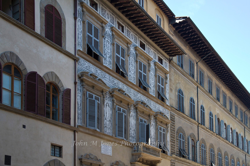 Buildings decorated with Graffiti, or etching through a white layer of plaster to reveal a dark layer of plaster, Florence, Firenze, Italy