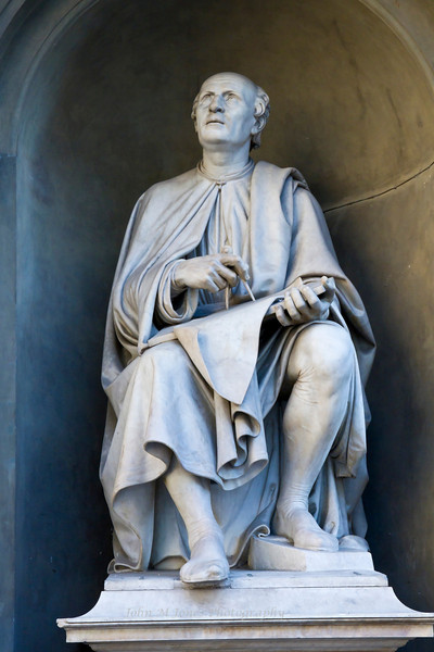 Statue of Filippo Brunelleschi by Luigi Pampaloni, looks up toward his dome from the Palazzo dei Canonici, Florence, Firenze, Italy