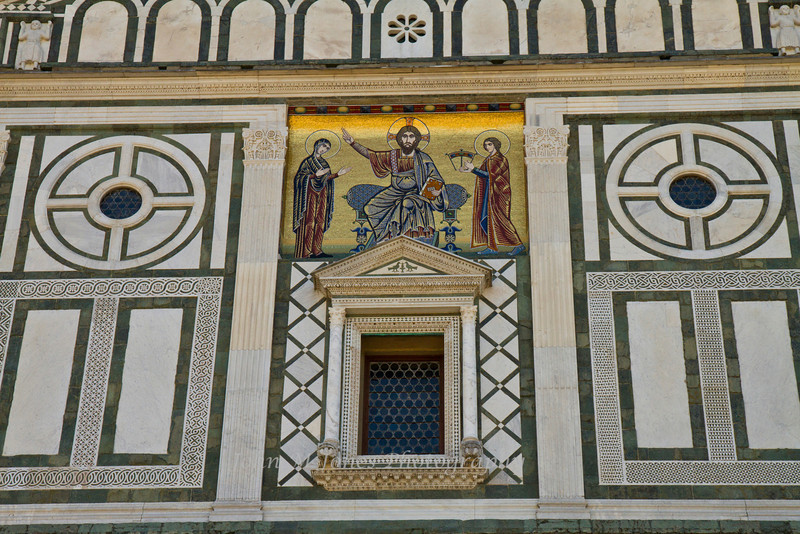 Mosaic on the facade of the San Miniato al Monte Church was added in the 13th century, and depicts Christ with Maria and St. Minias, Florence, Firenze, Italy