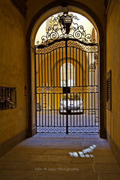 Gate and garage, Florence, Firenze, Italy