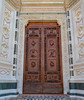 Fine wood carvings accent the doors at Basilica di Santa Croce.