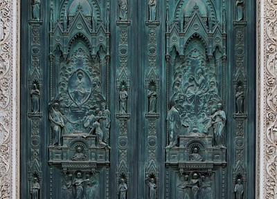 Close up detail of the Florence Duomo main door art created and installed from 1899 to 1903.