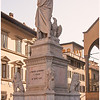 Statue of Dante Aligheiri in front of Santa Croce. Part of his remains are buried inside.