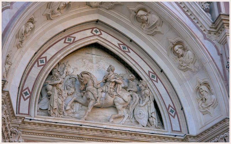Statuary above the door.