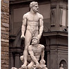 Hercules and Cacus. Hercules strangled Cacus for stealing his cattle. Cacus evidently breathed fire.