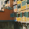 Detail of the shops/apartments built onto the Ponte Vecchio. Such wondrous colors in early morning light.