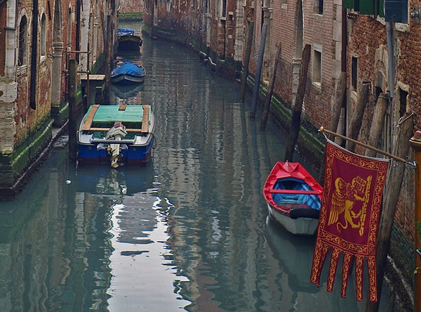 Lots of atmosphere in the side canals too. Note the Venetian lion on the flag.