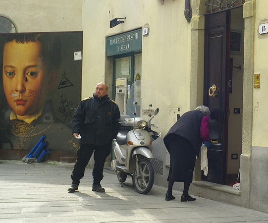 Back in Florence. What are they all looking at - including the guy on the poster?