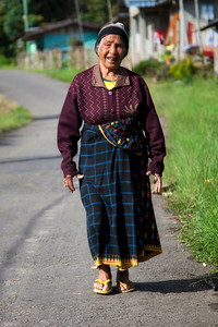 Elderly woman walking the road