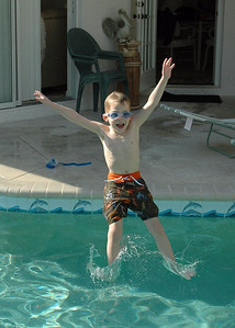 Alex jumping in pool