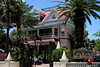 """<b>Casa Cayo Hueso</b> - <a href=""""http://www.southernmosthouse.com/about-us/keywest-historic.aspx"""" target=""""_blank""""> <b>The Southernmost House</a></b> in the Continental United States is located on the ocean.  It was built in 1896 for a cost of $250,000 (approximately $6 million today) by Judge J. Vining Harris, who married into the prominent Curry family. In 1939, the Ramos family purchased the property, which had been converted into a Cuban nightclub called Café Cayo Hueso (Bone Island Café), for $49,000.<br> <br> In 1954, it was converted back into a residence and remained so until 1996 when a $3 million restoration began to turn it into a 13-room hotel, with a museum on the first floor. Exterior paint colors are authentic, as are elegant crown moldings, ceiling medallions, ornamental woodwork and friezes, which were originally painted white, but have been redone in splashy shades reminiscent of its days as a Cuban nightclub. (June 4, 2008)"""