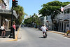 """<b>Duval Street</b> - Corner of Greene Street and Duval Street - Home to Sloppy Joe's.  Scooters and Key West go hand in hand.<br> <br> Duval (DOO-VAHL) Street runS north and south from the Gulf of Mexico to the Atlantic Ocean. From shore to shore, the street is just over a mile in length. It is named for William Pope Duval, the first territorial governor of Florida. Duval Street was designated a """"Great Street"""" in 2012 by the American Planning Association. The beautiful Bahamian and Spanish influenced Victorian Mansions of Duval Street have been well preserved through local preservation efforts starting in the 1960s. (June 4, 2008)  [B]"""