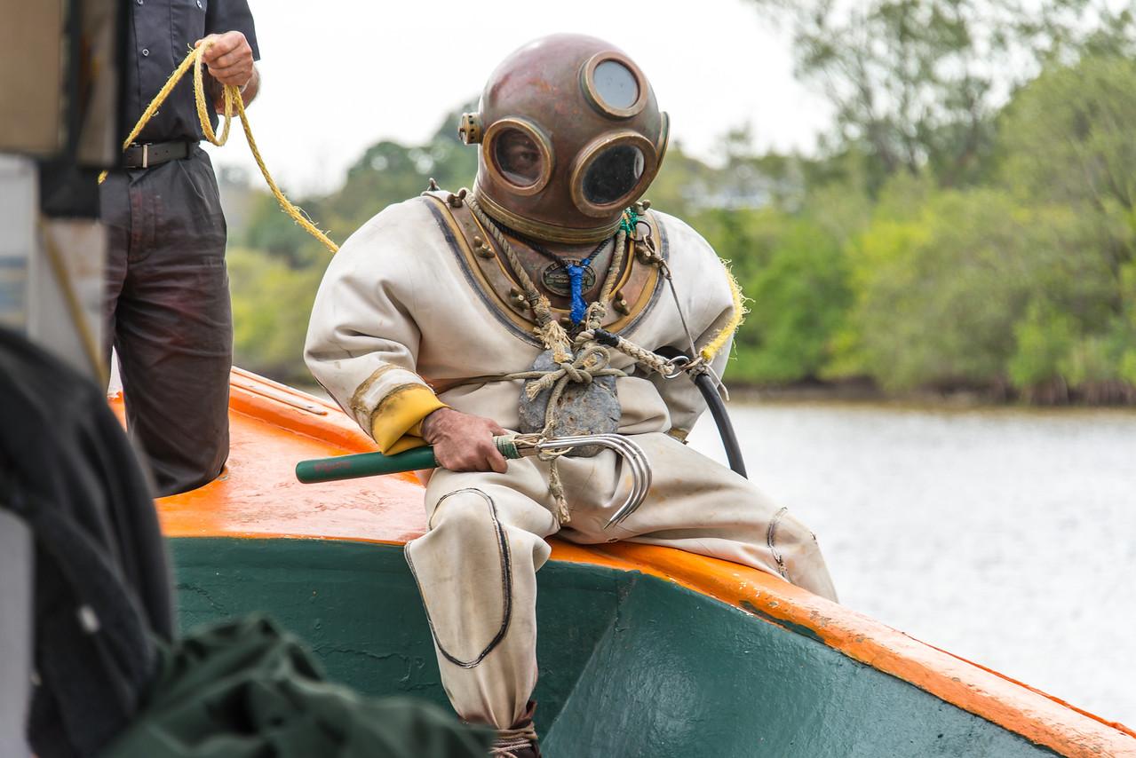 "Greek sponge diver preparing to demonstrate the ""hard hat method"" of sponge diving used in the early 20th century.  Tarpon Springs, Florida - February 2015"