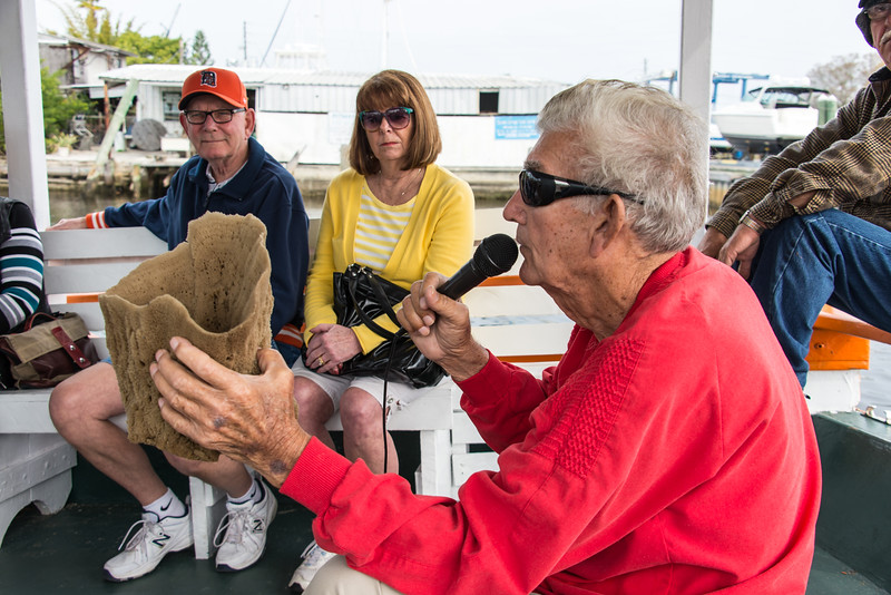 Retired Greek sponge diver discussing the properties of various sponges.  Tarpon Springs, Florida - February 2015