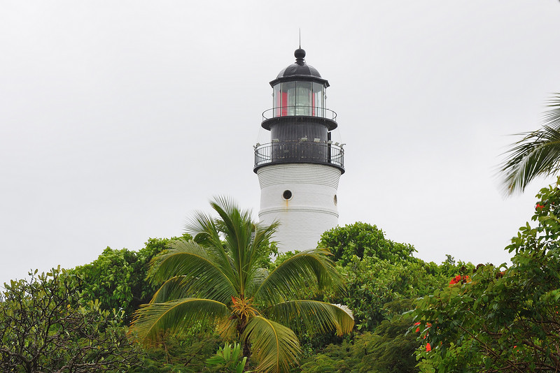 The Key West Lighthouse Museum seen from the Hemmingway House.  Hemmingway's friends used to joke that he needed the lighthouse to find his way home after a night out at Sloppy Joe's (still there).