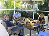 "Danny, Lee and Viki enjoying breakfast in the screened-in ""lanai."""