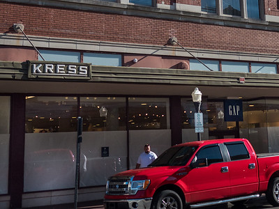 Detail: The Kress logo on the edge of the awning and Gap signage above today's store entrance.
