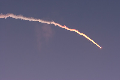 We could actually see the separation of the solid rocket motors (look for little hook smudges in photo) -- Delta 2 launch of GPS satellite, as seen from  Jetty Park, Cape Canaveral, FL (6:35am, Aug 17, 2009)