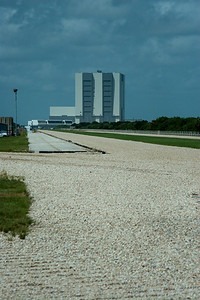 The gravel road for the crawler transporter, looking back towards the VAB. -- Touring the Kennedy Space Center