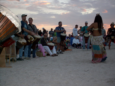 "'SUNSET DRUMMING CIRCLE on the beach - Casey Key / Nokomis   WHEN:   Sat. – gathering between 6-7pm-ish (it's VERY spontaneous!!).  Wed. also in Peak Season – I think that's about U.S.Thanksgiving to Easter).    This Is one of the activities I MISS THE MOST living in Costa Rica!!!  Bring a drum or some sort of musical instrument & just join in (I put kidney beans in a plastic bottle & called it an instrument) or get in the middle & just move!!!  It's a WILD looking group of people!  JUST BE!!  VERY MUCH individuals!!  Hence you have lots of people that WISH they could be more free surrounding them watching – OCCASIONALLY joining in (that's SOOOO COOL!!!!).  Watch VERY CAREFULLY for the ""Green Flash"" that few people are blessed to see (not me yet) that happens JUST as the sun hits the horizon.  People then cheer/bless the day off!!  This is NOT the party place that I've observed the times I've been to the Sarasota circle so even kids are welcome (I think it's GREAT to bring kids not used to being around ""different"" types of people as it opens their eyes/hearts to see people that are different are just that – different – NO threat & maybe they'll feel inspired to be more free in their world!!     See pics at http://escape-to-sarasota.com/nokomis-beach.htm / http://NokomisBeachDrumCircle.com  There's a publication - Bay Area Drumming that you can get a free internet copy of at BayAreaDrumming@TampaBay.rr.com  Check out this great video by Andy Browne https://vimeo.com/105491327"