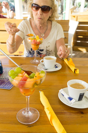 Our morning fresh fruit cup and café.