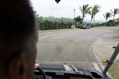 Lee driving the Mini Moke down the hill to the beach.