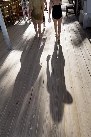 Shadows on a boardwalk.