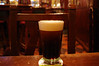 A glass of Guinness settling at the St. James Gate Irish Pub.