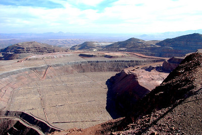 1/17/07 - To the right of the center can be seen two of the large mine dump trucks approaching a shovel.  The next photo brings them closer, showing more clearly their immense size.
