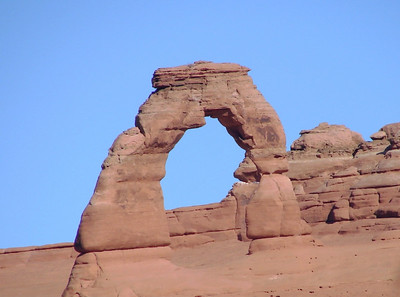 1/16/07 - Delicate Arch - perhaps the most photographed of all the natural attractions in the park.  This was taken with a 12x telephoto after walking out onto the slickrock from the upper trail at the Arch viewpoint.