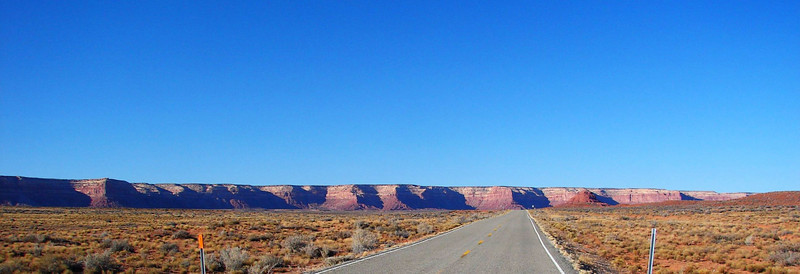 1/15/07 - Just north of Mexican Hat, Utah SR261 turns left off US-163 and heads toward a seemingly unbroken line of near-vertical cliffs.  As a driver approaches, he finds himself looking for an opening through which a highway might climb to the top of the plateau.