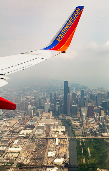 """Hazy view of downtown Chicago:  Willis (pronounced """"Sears"""") Tower in the center."""