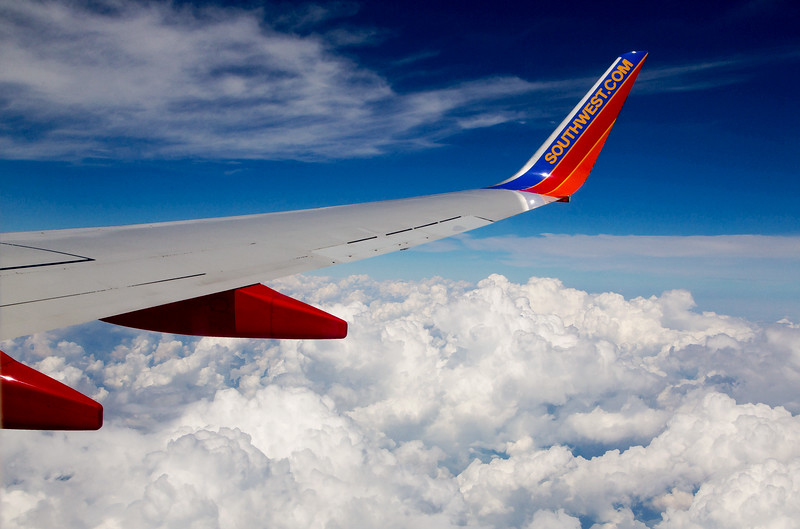 Clouds, sky, and a winglet
